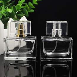 Perfume Bottles Pumps NZ - High-Grade 30ml Empty Clear Cosmetic Glass Perfume Bottles Square Sprayer Bottle With Gold Silver Pump Sprayer Free Shipping