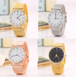 Glasses Trade Australia - 30pcs Free shipping Foreign trade sales speed sell hot style alloy Geneva watch ladies fashion color Circular mesh belt tab quartz watch