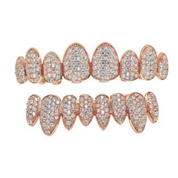 Wholesale 18K Gold Rock White Zircon Teeth Grillz New Arrive Copper Upper Bottom Braces Grillz For Male Female