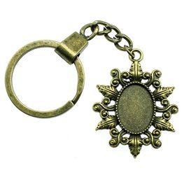 $enCountryForm.capitalKeyWord NZ - 6 Pieces Key Chain Women Key Rings Couple Keychain For Keys Small Grass Leaf Inner Size 13x18mm Oval Cabochon Cameo Base Tray Bezel Blank