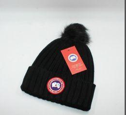 Marca de inverno de luxo canadá homens gorro designer de moda bonnet mulheres casuais tricô hip hop gorros pom-pom crânio tampas de cabelo bola ao ar livre chapéus
