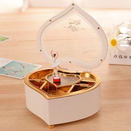 Box Crank NZ - Heart Shape Dancing Ballerina Music Box PLastic Jewellery Box Girls Carousel Hand Crank Music Box Mechanism Gift