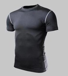China Quick drying fitness clothing men short-sleeved bodysuit high elastic air speed dry basketball running training T-shirt. suppliers
