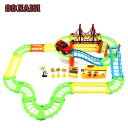 China DIY Electric Racing Rail Vehicle Car Kids Train Track Model Toy Baby Railway Track Racing Road Transportation Building Slot Sets cheap toy railway track suppliers
