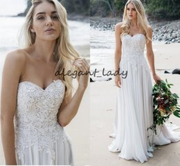 Strapless Fitted Waist Wedding Gown With Soft Flowing Chiffon Skirt With Train Delicate Lace And Pearl Detailing Beach Bridal Dress