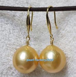 7a8939ba9460 ENORME 15-16 mm natural AAA South Sea dorado Pendientes de perlas 14K ORO  AMARILLO