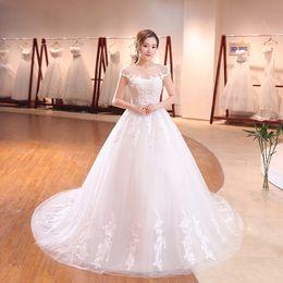 $enCountryForm.capitalKeyWord NZ - Wedding Dresses Ball Gowns Sheer Neck Short Sleeve Bridal Dresses Backless Appliques Crystal Bridal Gowns Sweep Train Vestidos de novia