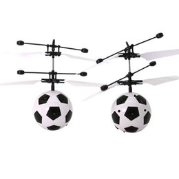 hand helicopter toy NZ - Luminous Flying Ball Hand Induction Flying Football Aircraft Funny Gadgets RC Drone Helicopter football toys. J