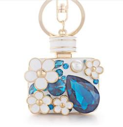 Water Bottles For Boys Canada - Enamel Flower Rhinestone Bottle Keyrings Crystal Bag Pendant For Car Key Chains Holder Rings Women Jewelry