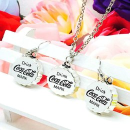Holiday Earrings NZ - New Hot Sale Zinc Alloy Antique Silver Cola Bottle Cap Charm Pendant Necklace Earring Set Creative Women Jewelry Accessories Holiday Gift