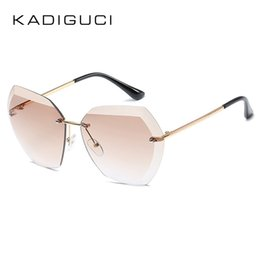 Chinese  KADIGUCI 2018 New Fashion Rimless Sunglasses Women Men Candy Color Metal Frame Brand Designer Pink Red HD Goggle for Ladies UV400 K0286 manufacturers