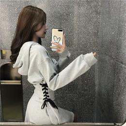aead683ed Otoño nueva moda coreana de las mujeres con capucha de manga larga sexy  cintura delgada vendaje cordones una línea de vestido de sudadera gris negro