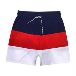 ac5081b5ea Venta al por mayor nueva bordado de cocodrilo cortocircuitos de la playa  Mens Summer Beach Shorts Pants Traje de baño de alta calidad Bermuda Male  Letter ...