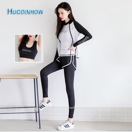 Wholesale HUCOINHOW Women Sport Suit Set Including Jacket Shirts Bra And Full Pants Korean Tight Slim Yoga Set Women s Tracksuits