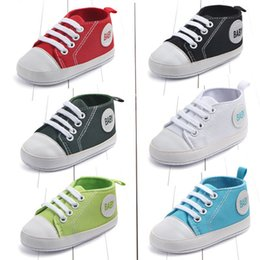 wholesale canvas high shoes Canada - Hot Sale Factory Price Kids Classic High-Tops Canvas Soft Sole Rubber Baby First Walker Baby shoes 13 colors Free Shiping