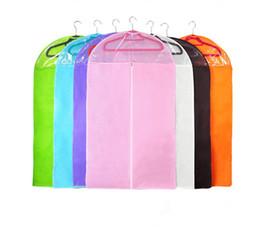 35a6c0939e7e 100pcs lot Non-woven Clothing Dustproof Cover Suits Coats Dust Clothes  Garment Bag Storage Protector Organizer Bag SN1343