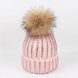 Trendy Diamond Knitted Winter Hats For Women Raccoon Fur Pompom Hat Female  Shining Warm Acrylic Beanies 240e4f4b1b25