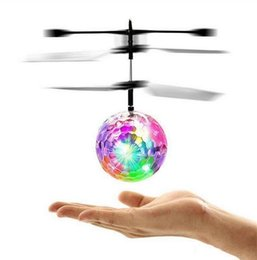 Discount flying helicopter toy remote - RC Toy RC Flying Ball Infrared Induction Helicopter Ball With Rainbow Shinning LED Lights Remote Control Flying Toys For