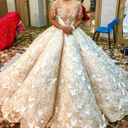 Sheer Crystals Gowns NZ - Luxury Golden Lace Wedding Dress Sheer Jewel Neck Short Sleeves Butterfly Applique Saudi Bridal Gown Glamorous Crystal Beads Wedding Dresses