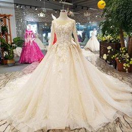 $enCountryForm.capitalKeyWord Australia - Luxury Light Champagne Bride Dresses O-Neck Long Sleeves Organza Wedding Gown With Train China Real Factory Drop Shipping Cost