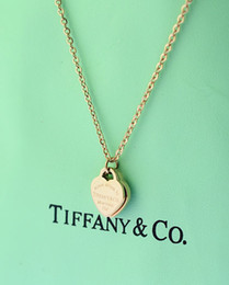 Heart sHape plastic box online shopping - High Quality Celebrity design Letter Silver Clover necklace Silverware Fashion Metal Ring Heart shaped Pendant necklace Jewelry With Box