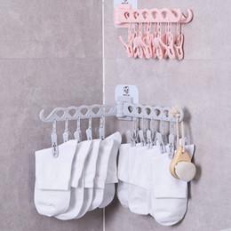 Clip shelf online shopping - Socks Rack Clip Sticky Wall Hanger Folding Drying Rack Underwear Household Multi functional Clothes Rack For Bathroom Kitchen GGA1325