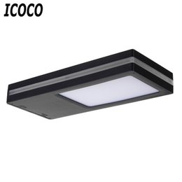Solar Powered Balcony Lights UK - ICOCO Waterproof Solar Powered Mition Sensor Energy Saving Security Lamp Brightness Induction LED Planel Light for Balcony Sale
