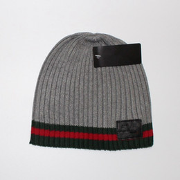 Chinese  Hight quality men women autumn winter beanie casual knitted sports cap black white Grey skull caps manufacturers