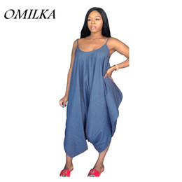 OMILKA 2018 Summer Women Spaghetti Strap O Neck Harem Denim Rompers and Jumpsuits  Casual Loose Backless Jeans Plus Size Overalls 56af8435883d