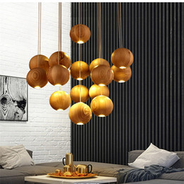 2017 Lustre de madeira Sólida moderna Chinês Japonês nórdico minimalista criativo sala de jantar três lâmpada de madeira de cabeça única em Promoção