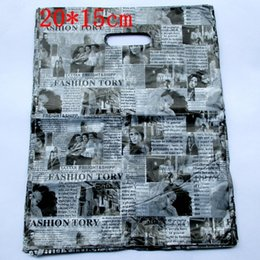 China 200pcs lot English Newspaper Design Plastic Gift Bag 20*15cm Clothes Jewelry Packaging Bag Big Plastic Shopping Bags supplier design plastic jewelry bags suppliers