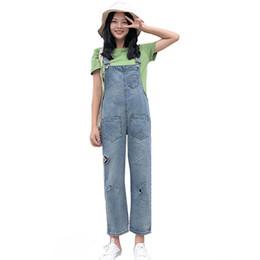 4a36824bc54 FDWERYNH Women Jumpsuit Denim Jeans Autumn Woman Hole Jeans Wide Leg Pants  Denim Overalls Female Casual Loose Pants Plus Size