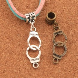 Handcuffs silver bracelets online shopping - 100pcs x10 mm Handcuffs Freedom Big Hole Beads Antique Silver Bronze Dangle Fit European Charm Bracelets Jewelry DIY B243