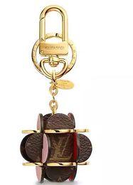 $enCountryForm.capitalKeyWord NZ - FLOWERING MONOGRAM BAG CHARM AND KEY HOLDER KEY HOLDERS BAG CHARMS MORE Belts Jewelry fashion Accessories