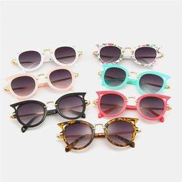 Venta al por mayor de Gafas de sol para niños Hollow Cat Face Baby Boy Girl Gafas de sol de moda Candy Color Leopard Floral Niños Beach Cat Eye Sunglasses T79
