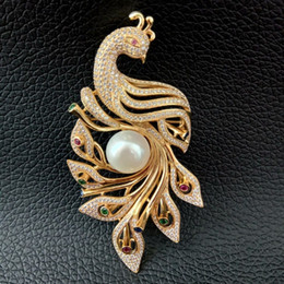 White Onyx Australia - BR101917 White Pearl Cz Pave Gold Plated Phenix Brooch