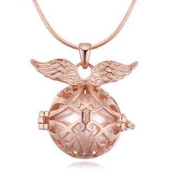 4c5d08cf30cec5 Pendants Necklaces Jewelry Fashion Women Exuqisite Quality Pearl 18K Gold  Plated Wings & Hollow Out Ball Clavicle Chain Necklaces TN042