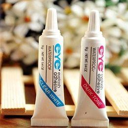 Ingrosso Colla Eye Lash Adesivo per trucco nero bianco Impermeabile Ciglia finte Adesivo Colla bianca e nera disponibile
