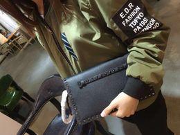 Ostrich Leather Clutch Bag Canada - best version~w203 black grain leather folded handle clutch bag 28*3.5*16 cm punk fashion