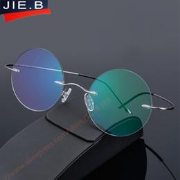 722869bd87 Aleación de titanio sin montura Anteojos Marco Diseñador de marca Hombres Gafas  Gafas de lectura Óptica Prescpriton Lentes Ronda