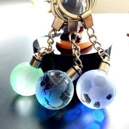 $enCountryForm.capitalKeyWord Australia - Seven Colour Crystal Ball LED Keychain Glass Ball Engraving 3D Football Globe Basketball Crystal Ball Colorful Keyring