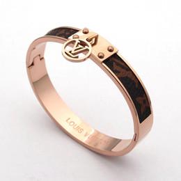 Ingrosso Moda popolare gioielli europei e americani designer di marca in acciaio inossidabile tono braccialetti pavimenta il braccialetto di cristallo lucido