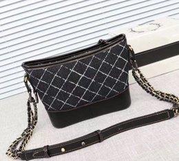 2018 couleur unie chaîne mode sauvage gland denim sac à bandoulière couture petit vent doux sac errant en cuir couleur diagonale femelle sac en Solde