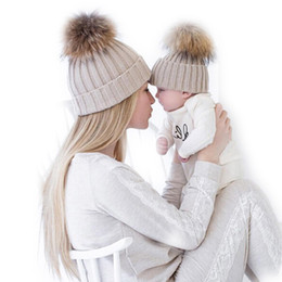 Chinese  Mother & Baby Hats For Newborns Photography Props Girls Boys Warm Winter Knitted Beanie Faux Fur Pompom Hat Kids Children Cap manufacturers