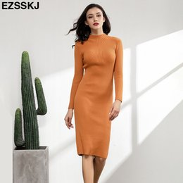 basic solid dresses NZ - 2018 slim female autumn winter midi sweater dress women sexy bodycon dress long sleeve robe solid Basic knitted dress balck C18110701