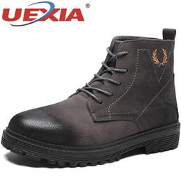 5cfe6fa8558 UEXIA Nuevas Botas de Moda para Hombre Marrón Negro Casual Casual Marca  Hombre Botas Antideslizantes Hombres Zapatos Planos Cómodo Joven Casual