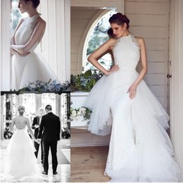 unique backless wedding dresses NZ - Unique Lace Detachable Train Mermaid Wedding Dresses Halter Backless Tiered Overskirt Chapel Bridal Gown Sweep Train Crystal Wedding Gown