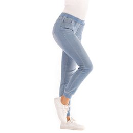 China New Hot Women Casual Elastic Waist Stretch Skinny Jeans Ladies Pockets Denim Trousers Slim Feet Pants Leggings Plus Size cheap ladies leggings feet suppliers