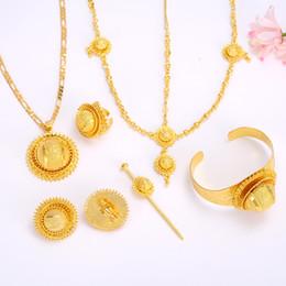 Intera venditaEthiopian Jewelry set Oro riempito ciondolo collane    orecchini   anello   braccialetto hairchain africano 24df8afcf89