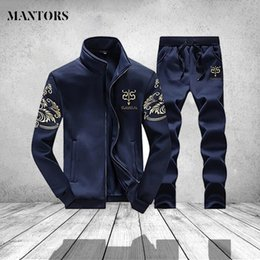 12acd5d3f49 Men Sportswear Tracksuit Brand Mens Fitness Clothing Long Sleeve Jacket and  Pants Male 2 Pieces Set Casual Men s Track Suit 4XL